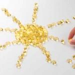 солнышко, выложенное капсулами с омега-3